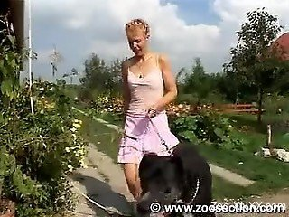 Short-haired chick gets banged by a black dog in the kitchen