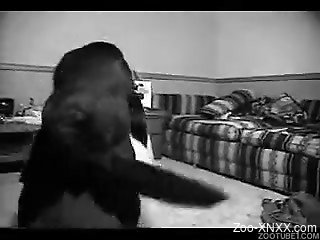 Black and white footage featuring a brunette with a dog